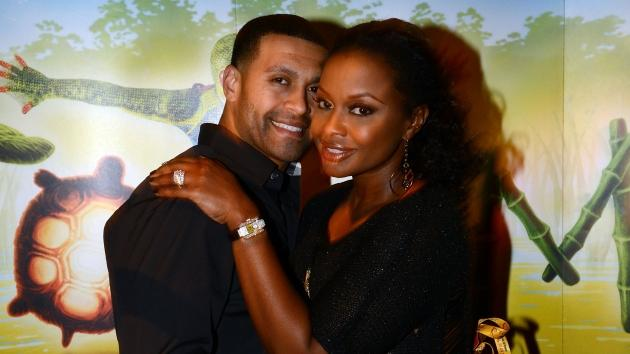 'Real Housewives of Atlanta' cast member Phaedra Parks (right) and Apollo Nida attend Cirque du Soleil TOTEM Premiere at Atlantic Station on October 26, 2012 in Atlanta, Georgia -- Getty Images