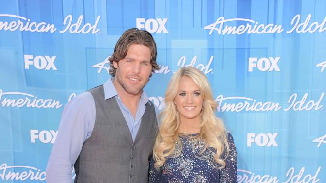 Carrie Underwood, right, and Mike Fisher arrive at the American Idol Finale on Wednesday, May 23, 2012 in Los Angeles. (Photo by Jordan Strauss/Invision/AP)