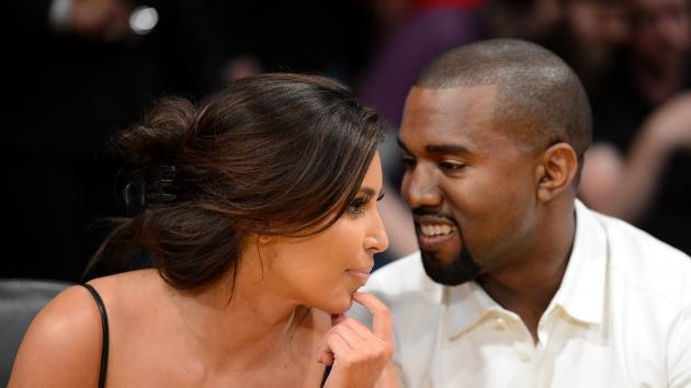 Kim Kardashian and rapper Kanye West talk from their courtside seats before the Los Angeles Lakers take on the Denver Nuggets in Game Seven of the Western Conference Quarterfinals in the 2012 NBA Playoffs on May 12, 2012 at Staples Center in Los Angeles -- Getty Images