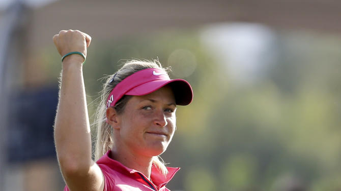 Suzann Pettersen, of Norway, celebrates a birdie on the 18th hole during the final round of the LPGA Kraft Nabisco Championship golf tournament in Rancho Mirage, Calif. Sunday, April 7, 2013. (AP Photo/Chris Carlson)