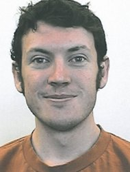 Police on Saturday prepared to enter an apartment rigged with explosives that belongs to the man believed to have opened fire at an opening of the latest Batman movie, killing 12 moviegoers. Police arrested the suspect shooter -- identified as 24-year-old James Holmes -- by his car at the rear of the theater, in Aurora, a suburb of the city of Denver, Colorado