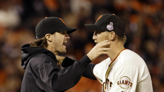 San Francisco Giants' Barry Zito, left, and Hunter Pence celebrate after Game 1 of baseball's World Series against the Detroit Tigers Wednesday, Oct. 24, 2012, in San Francisco. The Giants won 8-3 to take a 1-0 lead in the series. (AP Photo/David J. Phillip)