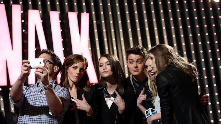 "IMAGE DISTRIBUTED FOR MTV - MTV News correspondent Josh Horowitz, from left, and cast members of ""The Bling Ring"", Emma Watson, Katie Chang, Israel Broussard, Claire Julien and Taissa Farmiga are seen at ""The MTV Movie Awards Sneak Peek Week"" on Friday, April 12, 2013 in Universal City, Calif. (Photo by Matt Sayles/Invision for MTV/AP Images)"