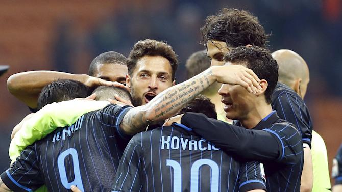 Inter Milan's players celebrate at the end of their Serie A soccer match against AS Roma at the San Siro stadium in Milan