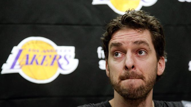 Los Angeles Lakers' Pau Gasol, of Spain, talks during an NBA basketball news conference in El Segundo, Calif., Tuesday, Feb. 19, 2013, about the death of owner Dr. Jerry Buss. Buss died in Los Angeles on Monday. (AP Photo/Chris Carlson)