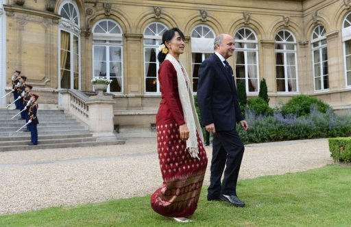 <p>Myanmar pro-democracy leader Aung San Suu Kyi (L) and France's Foreign Minister Laurent Fabius (R) walk in the garden of the Foreign Affairs Ministry in Paris, on June 27, 2012. Suu Kyi was to end her triumphant tour of Europe in France on Thursday, after being lauded during her visits as a model of peaceful resistance to dictatorship.</p>