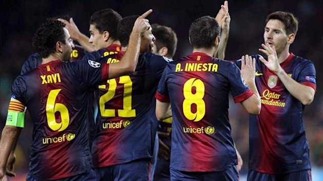 Barcelona celebrate their late goal against Celtic