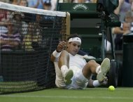 Rafael Nadal of Spain lies on the court after failing to return a shot to Lukas Rosol of the Czech Republic during a second round men's singles match at the All England Lawn Tennis Championships at Wimbledon, England, Thursday, June 28, 2012. (AP Photo/Anja Niedringhaus)