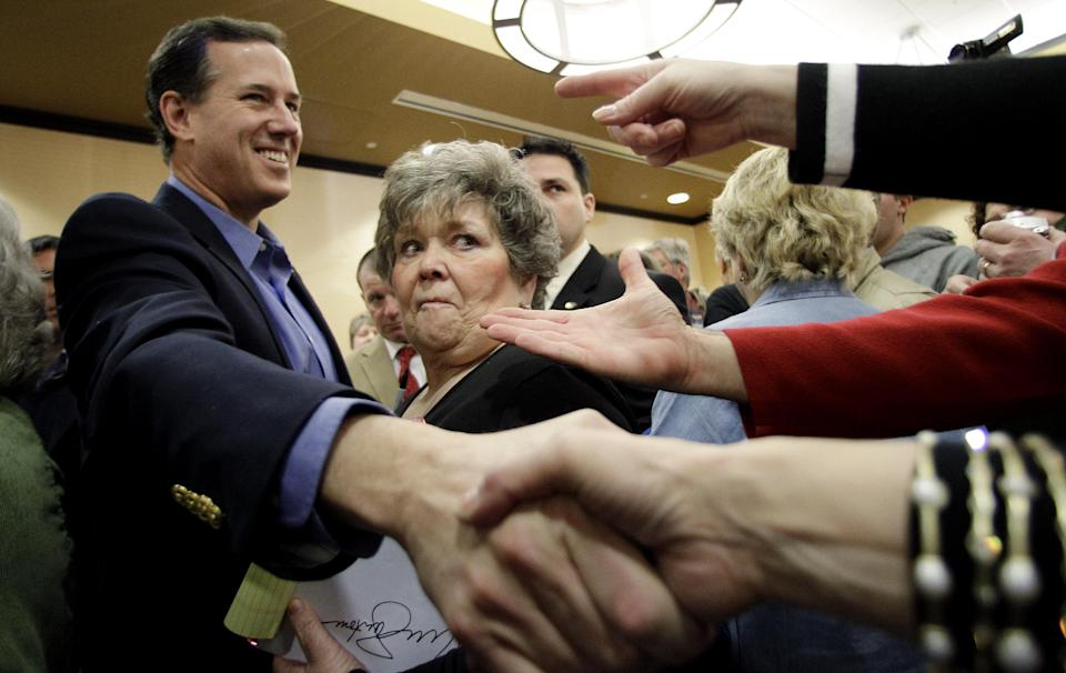 Republican presidential candidate, former Pennsylvania Sen. Rick Santorum, shakes hands during a Tea Party rally, Saturday, Feb. 18, 2012, in Columbus, Ohio.  (AP Photo/Eric Gay)