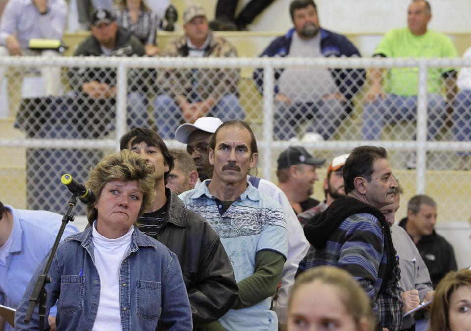 Claimants wait in line to speak with BP oil spill fund administrator Kenneth Feinberg, not pictured, during a town hall meeting in Houma, La., Tuesday, Jan. 11, 2011. (AP Photo/Patrick Semansky)
