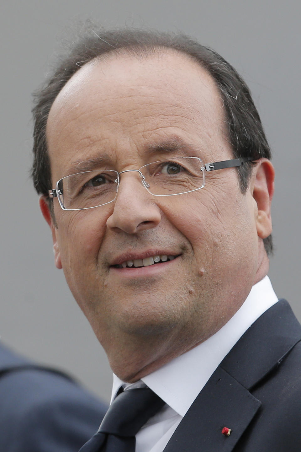 French president Francois Hollande watches the end of the 18th stage of the Tour de France cycling race over 222.5 kilometers (138.3 miles) with start in Blagnac and finish in Brive-la-Gaillarde, France, Friday July 20, 2012. (AP Photo/Christophe Ena)