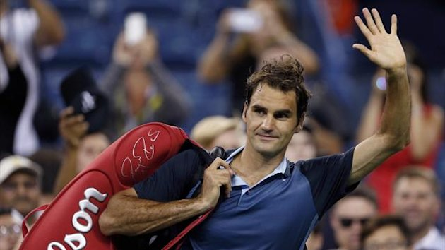 Roger Federer of Switzerland waves to fans as he leaves after defeating Adrian Mannarino (Reuters)