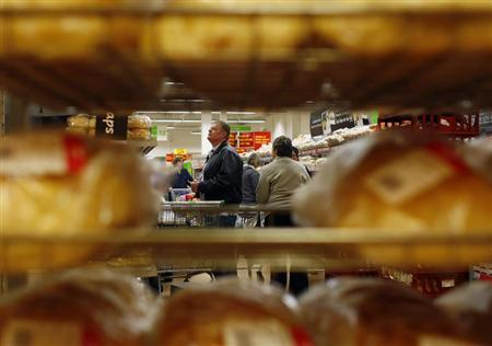 File photo of people shopping for groceries at an Asda store in High Wycombe