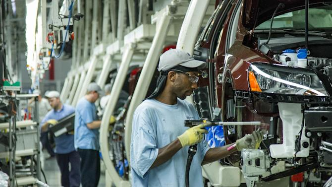 FILE - In this June 12, 2013, file photo, workers assemble Volkswagen Passat sedans at the German automaker's plant in Chattanooga, Tenn. Volkswagen supervisory board member Bernd Osterloh, head of the German automaker's global works councils, said on Thursday, Nov. 14, 2013, that the company's decision about whether to add production to its U.S. plant in Tennessee won't hinge on whether workers there gain union representation. (AP Photo/ Erik Schelzig, file)