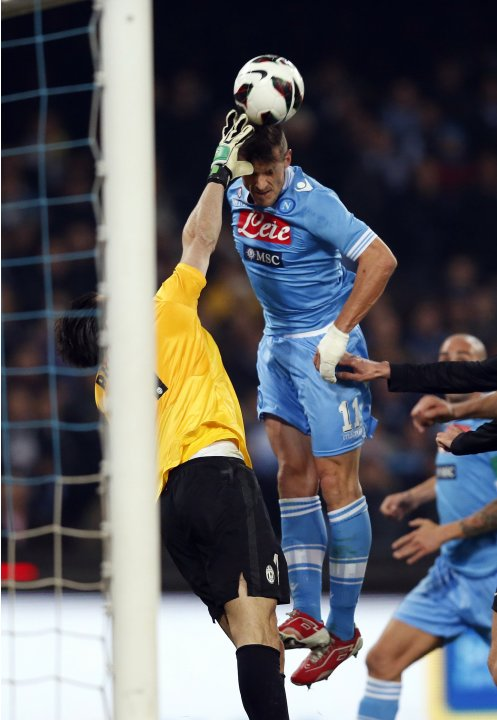Juventus' goalkeeper Buffon makes a save against Napoli's Maggio during their Italian Serie A soccer match at the San Paolo Stadium in Naples