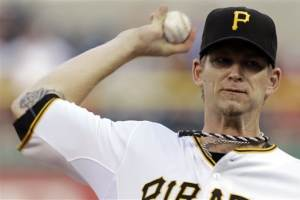 Burnett sparkles as Pirates top Reds, 2-1