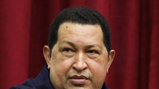 "In this photo released by Miraflores Press Office, Venezuela's President Hugo Chavez speaks during a televised program from the Miraflores presidential palace in Caracas, Venezuela, Wednesday April 11, 2012. Chavez returned to Venezuela Wednesday night and said he's ""doing well"" following cancer treatment in Cuba. Chavez flew to Cuba last week for his third round of radiation therapy. (AP Photo/Miraflores Presidential Office)"
