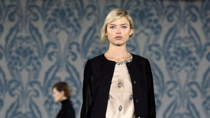 The Tory Burch Fall 2013 collection is modeled during Fashion Week in New York on Tuesday, Feb. 12, 2013. (AP Photo/Richard Drew)