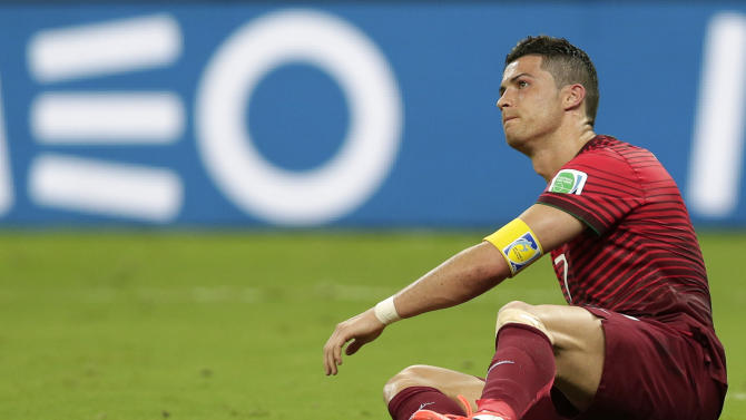 Portugal's Cristiano Ronaldo reacts to a play during the group G World Cup soccer match between the United States and Portugal at the Arena da Amazonia in Manaus, Brazil, Sunday, June 22, 2014. (AP Photo/Marcio Jose Sanchez)