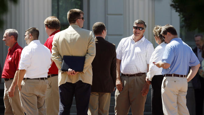 Legislators and other guests, including Wisconsin Rep. John Nygren (R-Marinette), facing, right, wait to enter the Brat Summit hosted by Wisconsin Gov. Scott Walker at the Executive Residence in the Village of Maple Bluff, Wis., Tuesday, June 12, 2012. Walker, just a week removed from his win in a recall election spurred by his taking on public sector unions, did not allow media into the cookout. He billed the bipartisan gathering as a way to heal political wounds following his first 18 months in office that has spurred massive protests and culminated with the unsuccessful recall attempt. (AP Photo/Wisconsin State Journal, M.P. King)