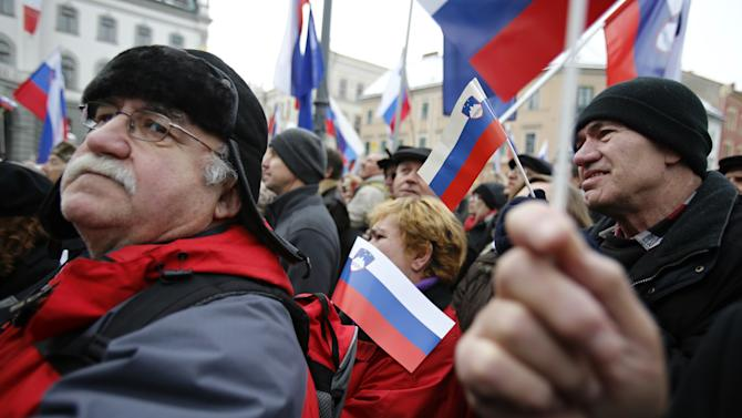 Slovenian government supporters take part in a political rally in Ljubljana, Slovenia, Friday, Feb. 8, 2013. Several thousand gathered to show support for troubled Slovenian Prime Minister Janez Jansa and his government. (AP Photo/Darko Bandic)