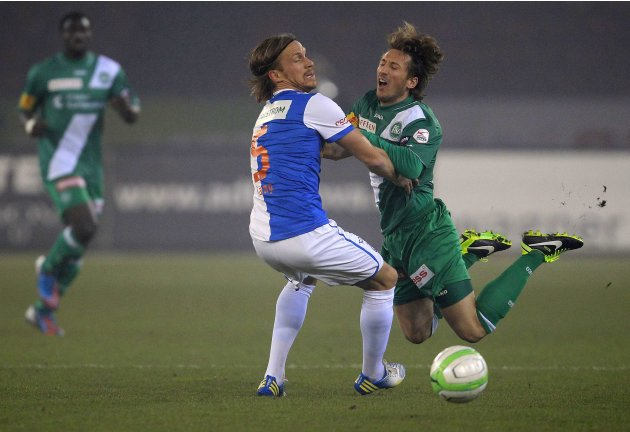 Grasshopper Club's Lang challenges Nushi of FC St. Gallen during their Swiss Super League soccer match in Zurich