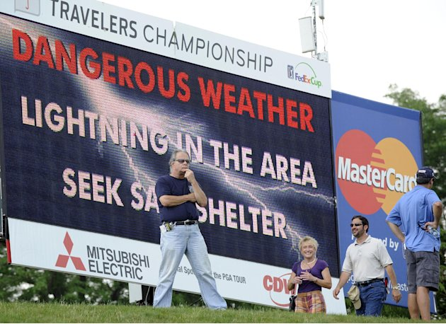 An unidentified spectator reacts to the announcement of a weather delay during the second round of the Travelers Championship golf tournament in Cromwell, Conn., Friday, June 22, 2012. (AP Photo/Fred