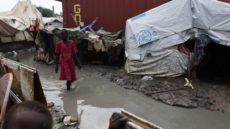 A girl walks through mud in the internally displaced persons camp inside the United Nations base in Malakal