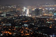 A night view of the South Korean capital Seoul. A South Korean banker was found dead in an apparent suicide Friday -- the day she was due to report to prosecutors investigating illegal lending, police said. The 50-year-old woman named Kim, an executive director of Mirae Savings Bank, was found hanging with her scarf in a Seoul motel, police said