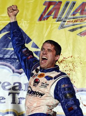 David Ragan celebrates after winning the NASCAR Sprint Cup Series Aaron's 499 auto race at Talladega Superspeedway in Talladega, Ala., Sunday, May 5, 2013. (AP Photo/Rainier Ehrhardt)