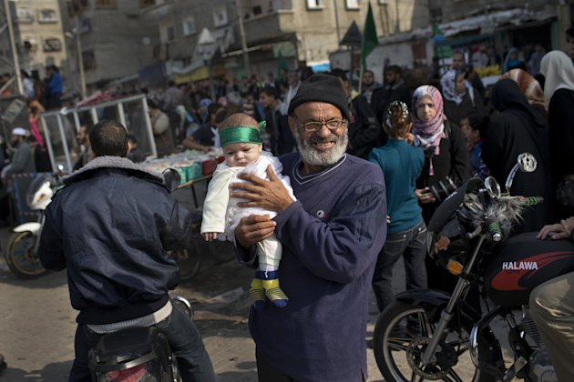 A Palestinian baby wears a Hamas bandana during a rally to celebrate the Israel-Hamas cease-fire in the Jebaliya refugee camp, north Gaza Strip, Thursday, Nov. 22, 2012. Gaza residents cleared rubble and claimed victory on Thursday, just hours after an Egyptian-brokered truce between Israel and Gaza&#39;s Hamas rulers ended the worst cross-border fighting in four years. (AP Photo/Bernat Armangue)
