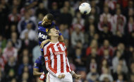 Stoke City's Peter Crouch, bottom, jumps for the ball against Manchester United's Rio Ferdinand during their English Premier League soccer match at the Britannia Stadium, Stoke, England, Saturday Sept. 24, 2011. (AP Photo/Jon Super)
