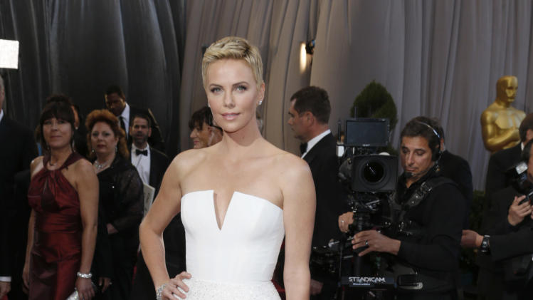 Actress Charlize Theron arrives at the Oscars at the Dolby Theatre on Sunday Feb. 24, 2013, in Los Angeles. (Photo by Todd Williamson/Invision/AP)