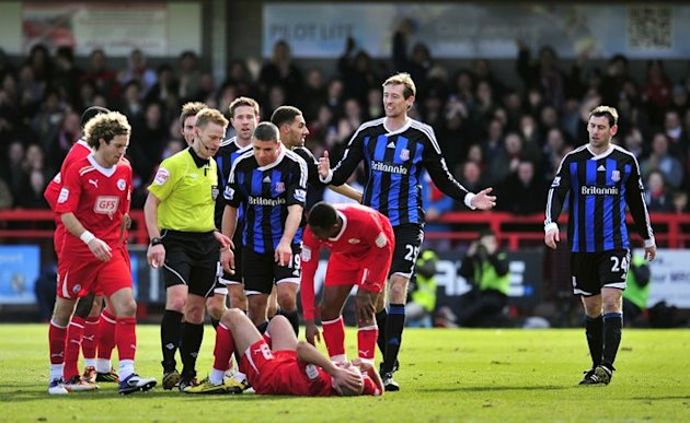Referee Michael Jones Walks Over To Crawley Town's Midfielder David Hunt 
