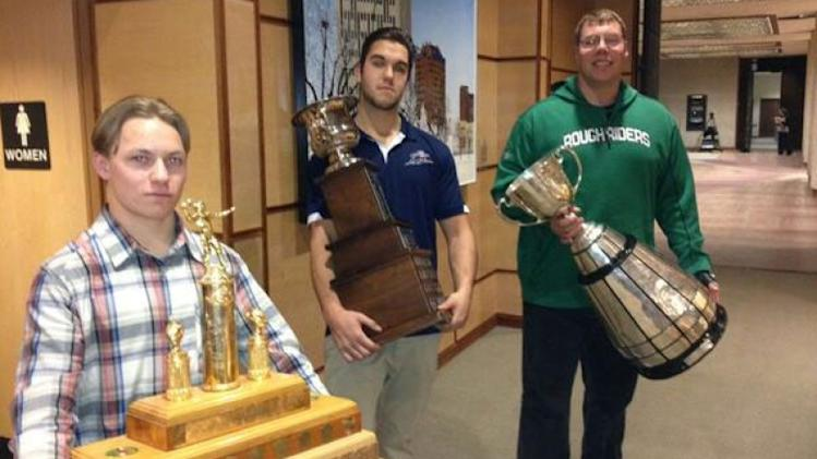 Trophies for high school, junior and the CFL championships were proudly displayed - together - Monday night at Regina city council.