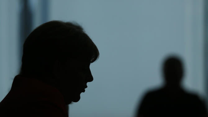German Chancellor Merkel is silhouetted as she addresses an annual news conference in Berlin