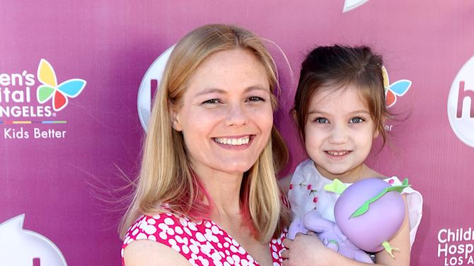 "IMAGE DISTRIBUTED FOR THE HUB - Meghan McCarthy and her daughter Sophie McCarthy attend The Hub TV Network's ""My Little Pony Friendship is Magic"" Coronation Concert at the Brentwood Theatre on Saturday, Feb. 9, 2013, in Los Angeles in support of Children's Hospital LA. (Photo by Matt Sayles/Invision for The Hub/AP Images)"
