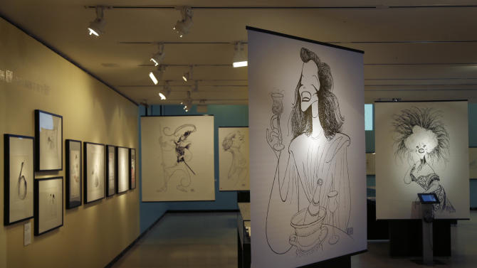 Drawings by Al Hirschfeld are displayed in an exhibit on the artist at the Library for the Performing Arts in New York, Wednesday, Oct. 16, 2013. The exhibit, which opens Thursday, Oct. 17, 2013, showcases work through Hirschfeld's career. (AP Photo/Seth Wenig)