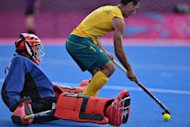 Australia's midfielder Jamie Dwyer (R) takes a shot against South Africa's goalkeeper Erasmus Pieterse during the preliminary round men's field hockey match of the London 2012 Olympic Games between Australia and South Africa in London. Australia won 6-0