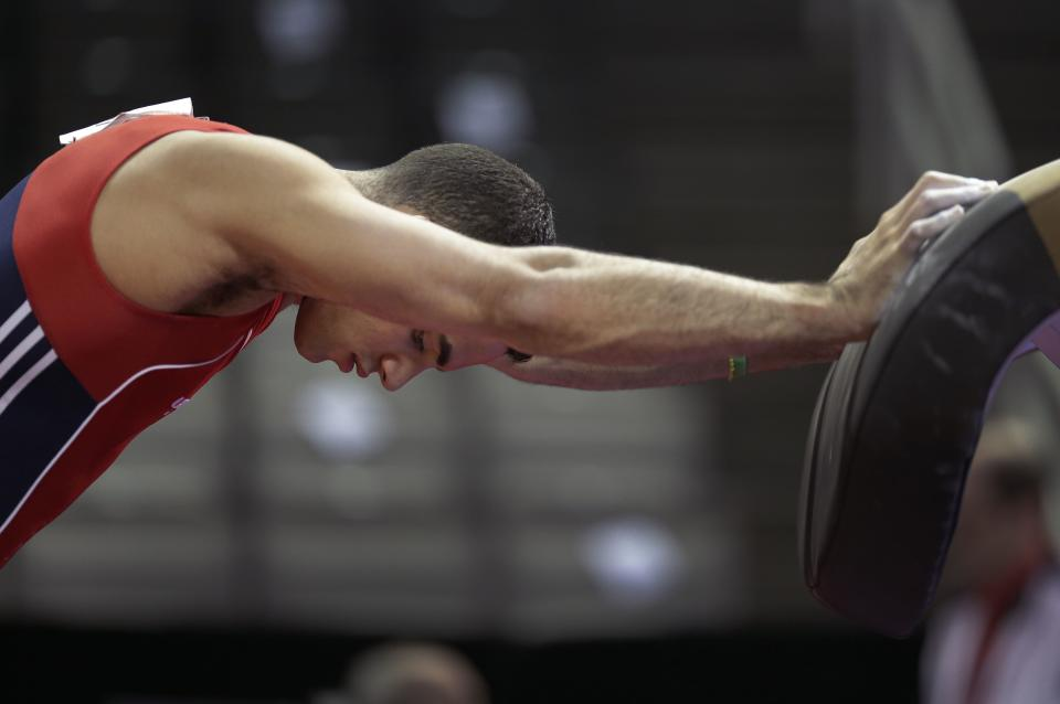 Danell Leyva stretches before competing in the final round of the men's Olympic gymnastics trials, Saturday, June 30, 2012, in San Jose, Calif. (AP Photo/Jae C. Hong)