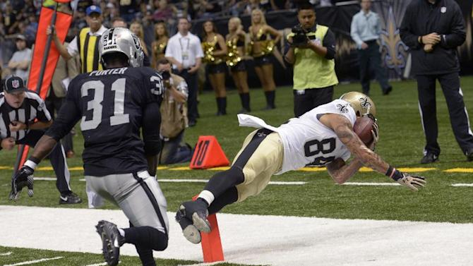Brees starts strong, Saints down Raiders 28-20