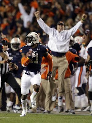 Davis' return lifts Auburn past Bama, 34-28
