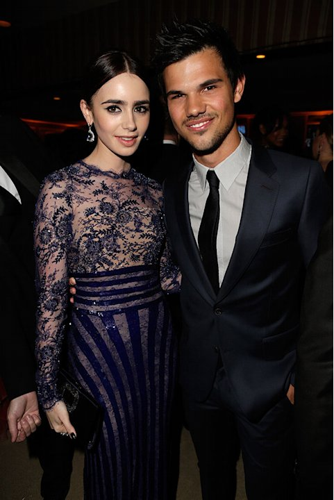 2013 Vanity Fair Oscar Party Hosted By Graydon Carter - Inside: Lily Collins and Taylor Lautner