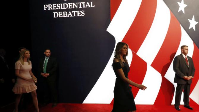 Melania Trump leads the trump family to their seats at the start of the first U.S. presidential debate at Hofstra University in Hempstead