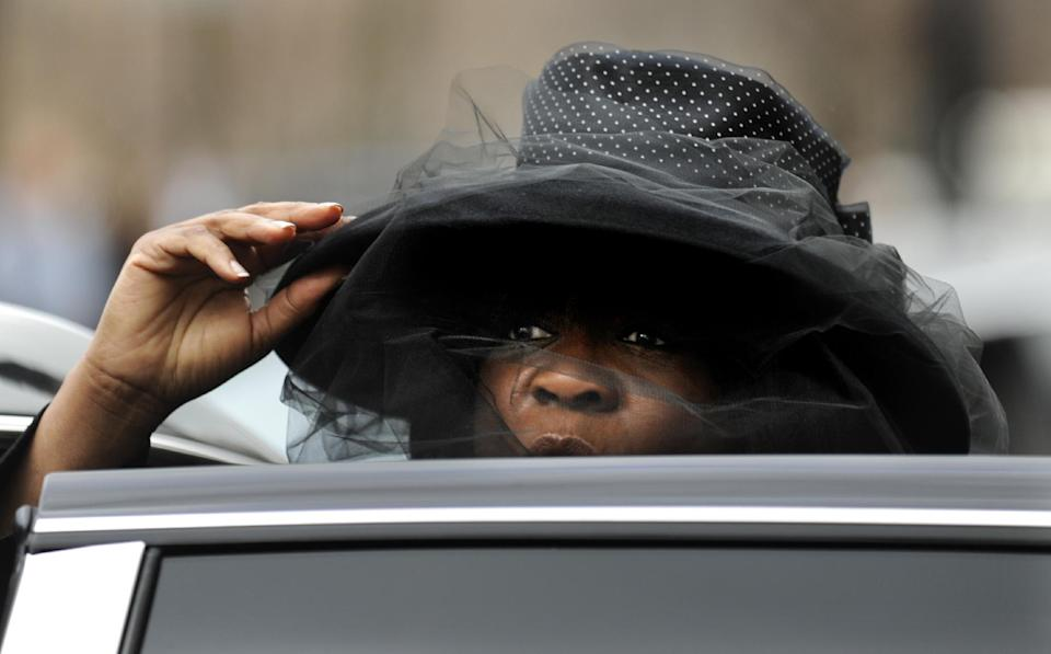 Chaz Ebert, wife of film critic Roger Ebert leaves Holy Name Cathedral after his funeral in Chicago, Monday, April 8, 2013. The Pulitzer Prize winning movie reviewer died Thursday, April 4 at age 70 after a long battle with cancer. (AP Photo/Paul Beaty)
