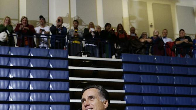 Republican presidential candidate, former Massachusetts Gov. Mitt Romney holds a bag of paper towels as he participates in a campaign event collecting supplies from residents and local relief organizations for victims of superstorm Sandy, Tuesday, Oct. 30, 2012, at the James S. Trent Arena in Kettering, Ohio. (AP Photo/Charles Dharapak)