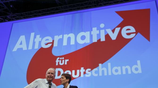 Petry and Gauland stands on the podium of the party congress of AfD at party congress in Essen