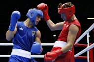 Patrick Wojcicki (L) of Germany defends against Alexis Vastine (R) of France during their first round Welterweight (69Kg) match of the London 2012 Olymipic Games at the Excel Arena in London. Vastine was awarded a 16-12 points decision