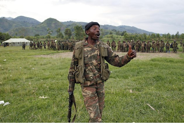 A member of the FARDC Congolese government special forces joins his colleagues in a stadium  near Minova Congo some 40 kms south-west of Goma, Thursday Nov. 29, 2012, for a moral building gathering an