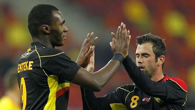 Belgium's Christian Benteke celebrates a goal with team-mate Steven Defour (Reuters)